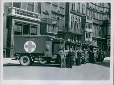 A photo of Britain Presents Ambulances to Danish Red Cross in the street - 13-7-45