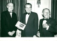 Richard Nixon flanked by Frank Pakenham and Charles Forte at Hyde Park Hotel
