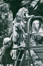 Princess Alexia of Greece and Denmark playing at the slide. 1971.
