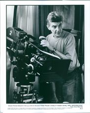 Director Rochard Benjamin lines up a shot on the set of TriStar Pictures' comedy of mistaken identity, Mrs. Winterbourne.