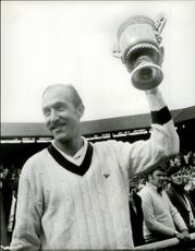 Tennis player Stan Smith won the tennis tournament at Wimbledon Station.
