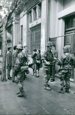 Soldiers guarding in front of building.