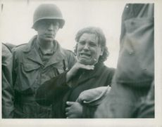 A Polish woman weeps as she tells her story to the troops of the Third Division, Seventh U.S. Army.