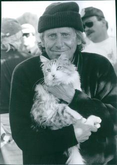 1997  Close up of Bob Spiers with cat in his arms from the comedy film