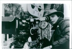1994 Close up of Peter Hyams, posing with camera on the set of film Timecop.