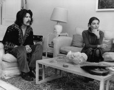 Princess Shahnaz Pahlavi sitting in a couch with a man.