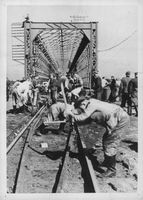 People busy working on constructing railway.