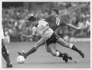 Dean Glover and Nigel Callaghan are fighting for the ball