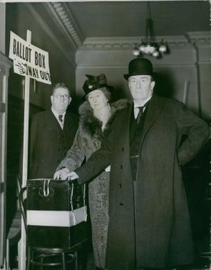 Mr. Stanley Baldwin and his wife casting their votes in the London county council election in to the ballot box. 1937.