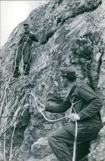 Soldiers on mountain climbing with the help of ropes in Germany.  1960