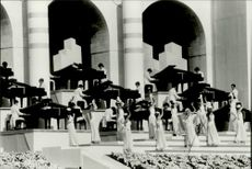 "OS in Los Angeles. 84 Pianists play ""Rapsody in Blue"" during the opening ceremony of the Los Angeles Memorial Coliseum"