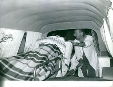 Man taking patient out of ambulance. A vintage photo from the Birgitte Bardot folder in a old press photo archive