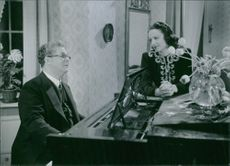 "Erik 'Bullen' Berglund and Signe Hasso in the film ""Den ljusnande framtid"", 1941."