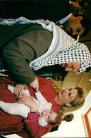 Yassir Arafat with his wife Suha and the daughter Zahwa in the lobby of the Ana Washington Hotel