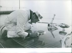 Man making design on the bow of the boat during a boat show in Paris. Photo taken on January 7, 1969.