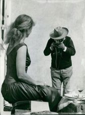 Evert Taube taking photograph of woman in 1957 in France.