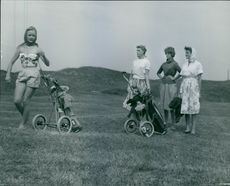 Princess Margaretha having fun with other women in a huge ground.