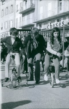 Teenagers using a unicycle. April 10, 1970