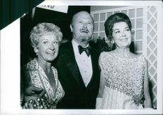 Rosalind Russell arrives for Gov. Reagan's party for Princess Alexandra with Jack and Bonita Wrather.