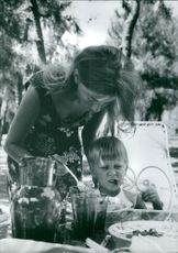 Queen Paola of Belgium feeding her son.
