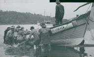 A rescue boat from the turn of the century is launched at the Maritime Museum