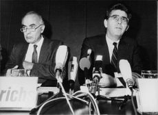 Hans Friderichs sitting with Heinz Durr during a press conference.