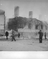 People witnessing a burning building in Finland.  - 1941