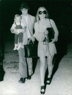 Swedish actress Ewa Aulin and her husband, British copywriter John Shadow proudly show off their first son, Shawn.