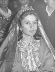 Lamia Solh wearing a traditional wedding gown and intricate tattoo on face during her wedding to Prince Moulay Abdellah of Morocco.