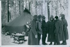 Soldiers standing together and having discussion.