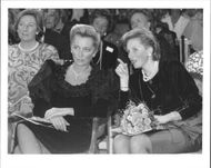 Princess Paola of Belgium with Princess Astrid in a fashion show by Louis Scherrer