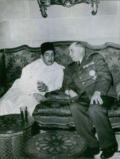 Alphonse Pierre Juin  siting with a prince.