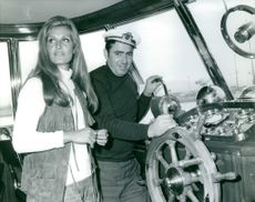 Dalida with a man in ship.