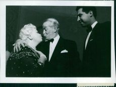 Maurice Chevalier kissing.
