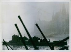 1944 German soldiers standing and moving by boat.