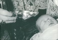 Monsignore Léon Lommel baptizes Jean and Josephine Charlottes son Henri at the parents' residence, the castle Betzdorf
