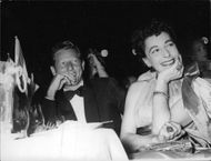 Danny Kaye with a woman, smiling.