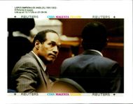 Defendant O.J Simpson listens to read back for the jury of testimony.