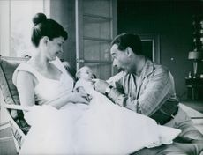 Victor Borge with his wife and their baby.