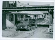 A military tank in street.