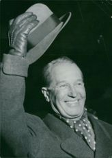Maurice Chevalier hats off.
