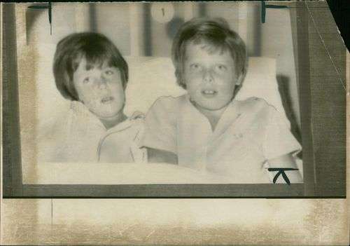 """Happy ending for the Shaw family after Bradley (left) and Mark had been buried in the ruble of their Spanish hotel. Mr. Norman Shaw had told his wife: """"Darling I'M afraid the boys are dead"""""""