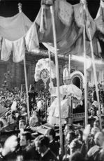 Pope Paul VI waving at crowd.