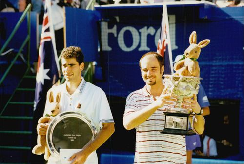 Andre Agassi proudly shows the prize after the win during the Barcy tournament.
