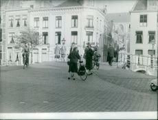 Princess Beatrix with a woman walking on the streets.