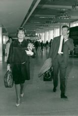 Simone Signoret and Yves Montand at Paris-Orly Airport