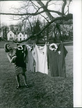 A girl hanging the laundry.