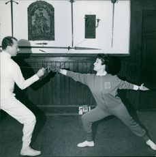 Silvana Pampanini at fencing school and practising with Maestro Greco.