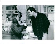 Holly Hunter as Claudia Larson and Dylan McDermott as Leo Fish in a conversation scene from the film