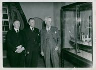 Amiral Wester, General Director Hägg and Marine Director Åkermark views a ship model at the Maritime Museum